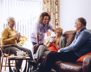caregiver and elders happily talking
