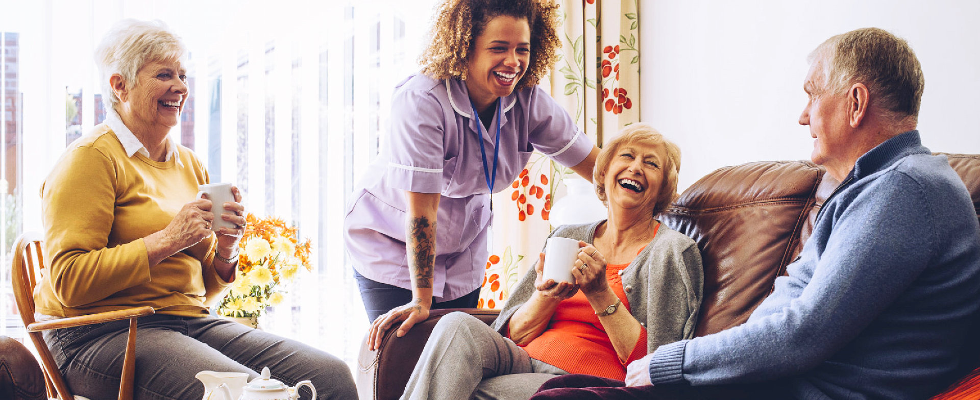 elders and caregiver happily talking
