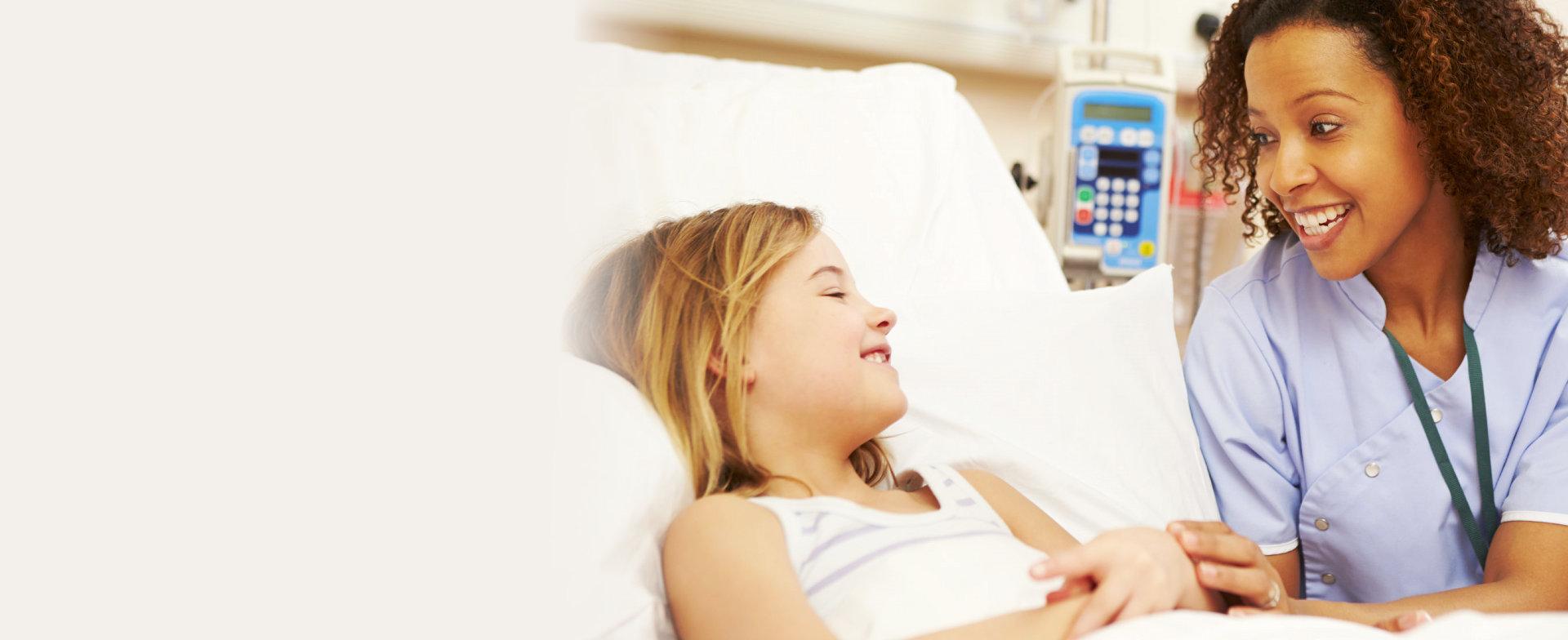 caregiver and little girl havin a fun conversation