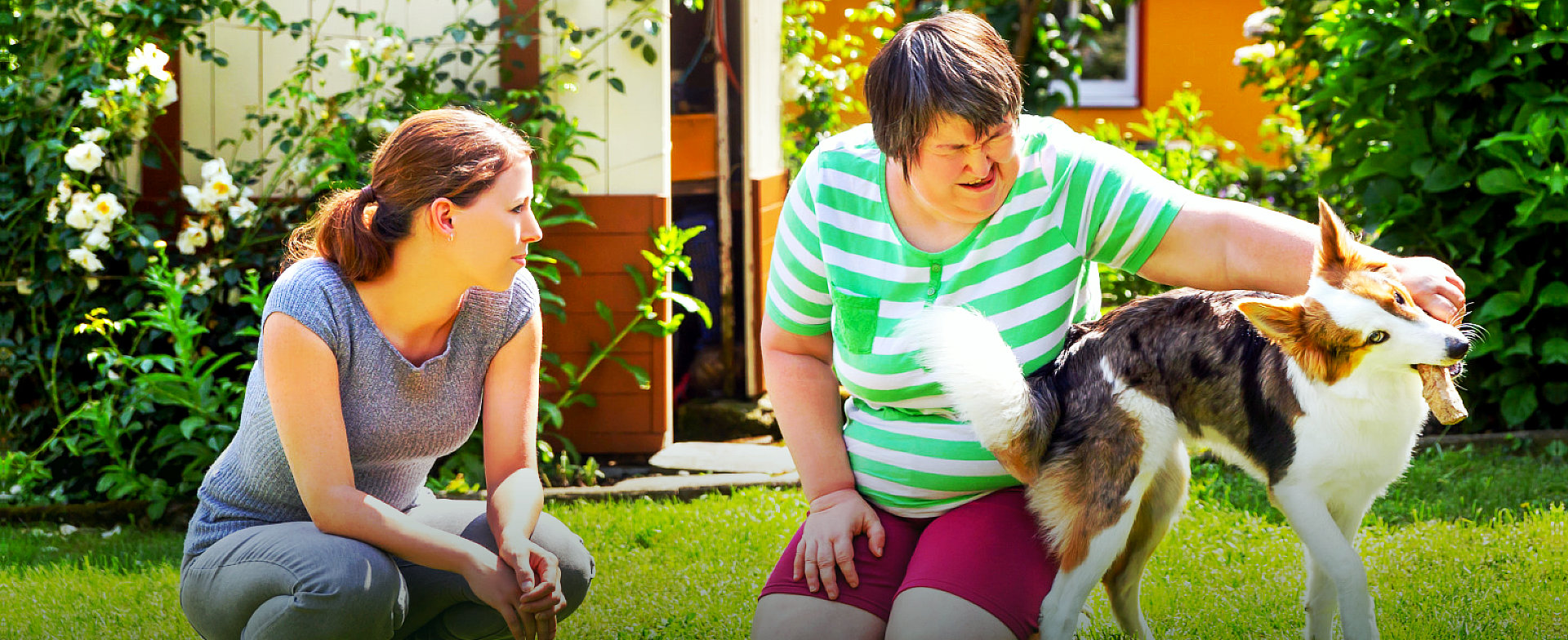 disabled woman with her pet and caregiver