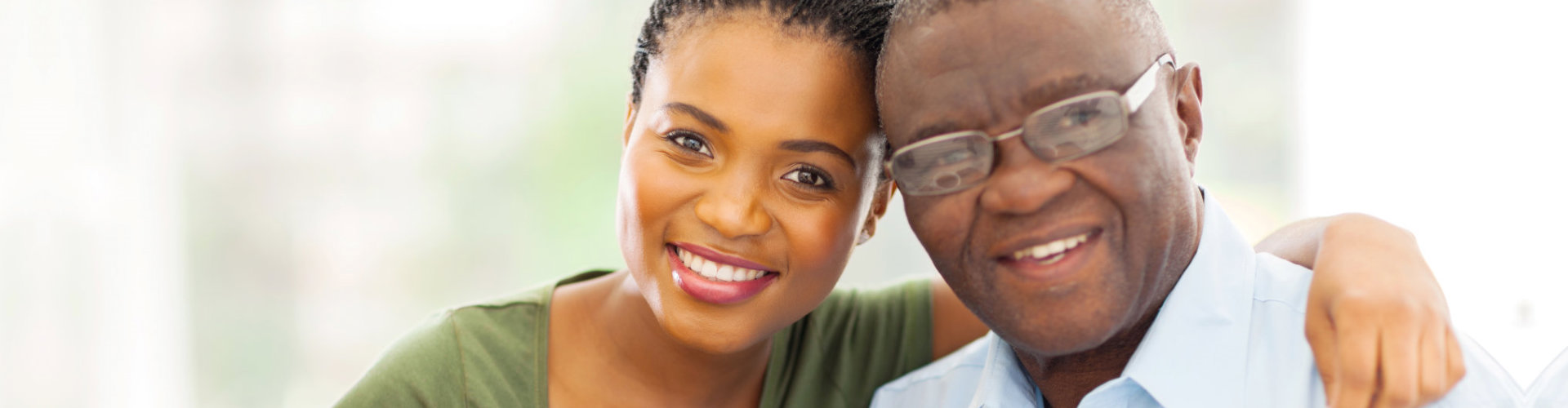 caregiver and old man smiling
