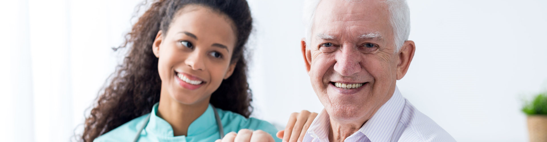 caregiver and old man smiling genuinely