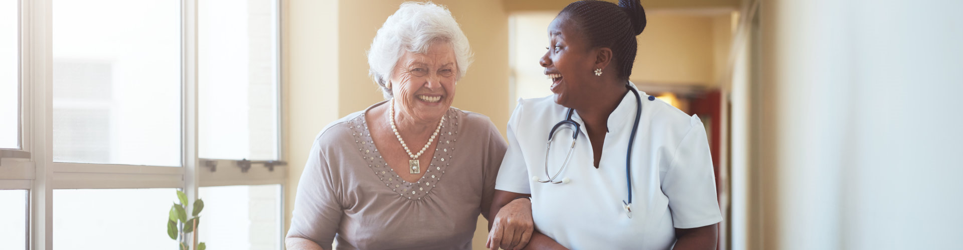 caregiver and old woman having a good time