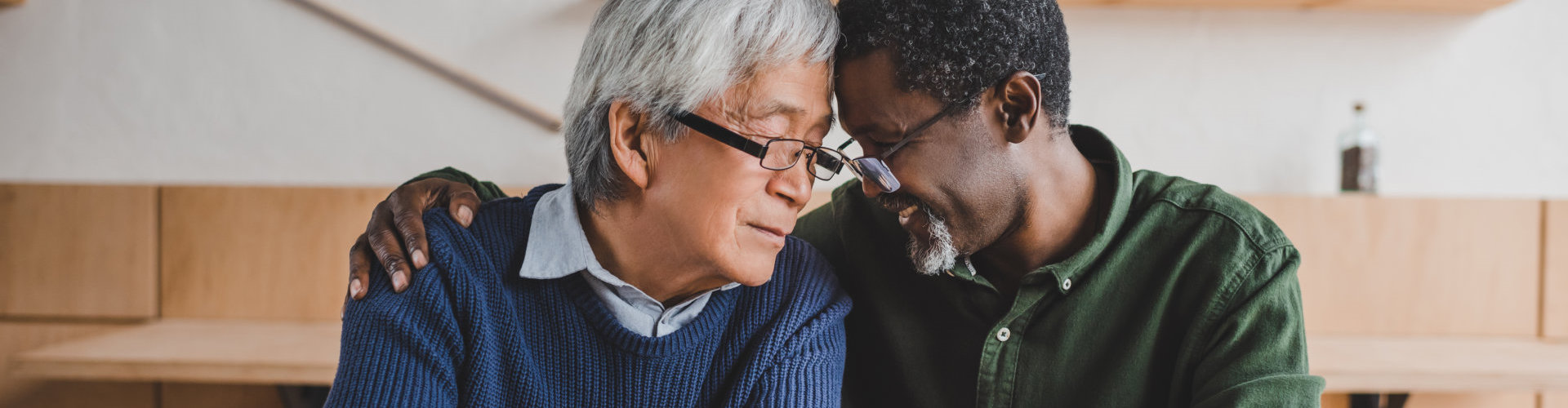 caregiver and old man talking